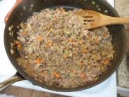 Break up the meat into small chunks using the back of a wooden spoon. Cook until browned and crispy. About 7-8 minutes.