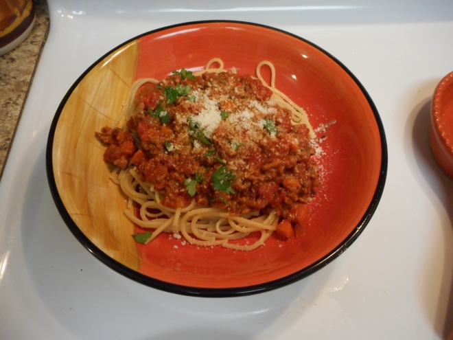 Serve with pasta or spaghetti squash. Sprinkle with additional cheese and parsley. Enjoy!