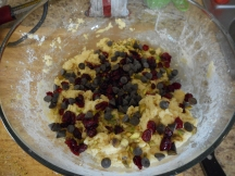Add the pistachios, cranberries, and chocolate chips....