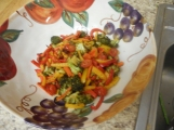 Add the tender roast vegetables to the pasta bowl.