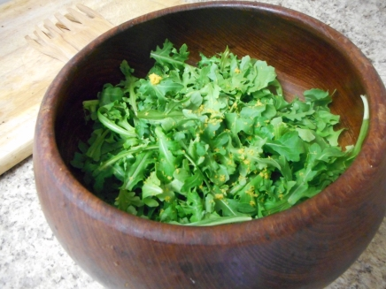 Zest the lemon right onto the arugula. Toss with the dressing before serving.