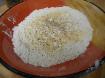 Make a seasoned flour with garlic powder, salt, and pepper in the flour.