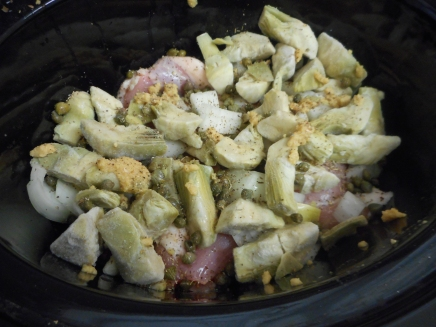 Place the chicken in the Slow Cooker. Cover with the onion, garlic, artichokes, capers, oregano, salt and pepper.