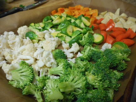 Arrange veggies on a baking sheet, drizzle with olive oil, sprinkle with salt and pepper.